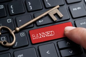Can a banned director be a shareholder?